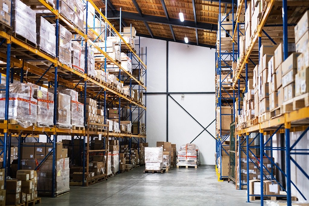 Warehouse requiring AI price optimization with shelves full of wholesale goods ready for distribution